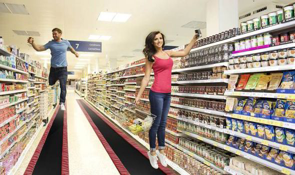 "alt=""Lucy Mecklenburgh promoting Tesco's trampoline aisles in the name of April Fools Day"""